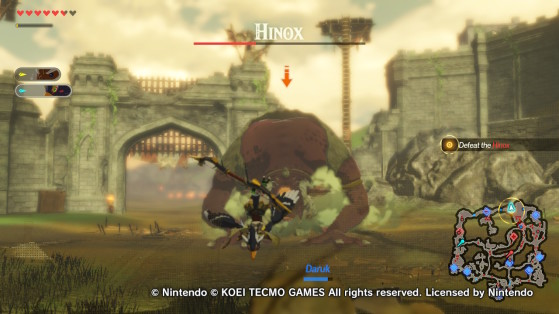Battling the Hinox in Hyrule Warriors: Age of Calamity. - Hyrule Warriors: Age of Calamity