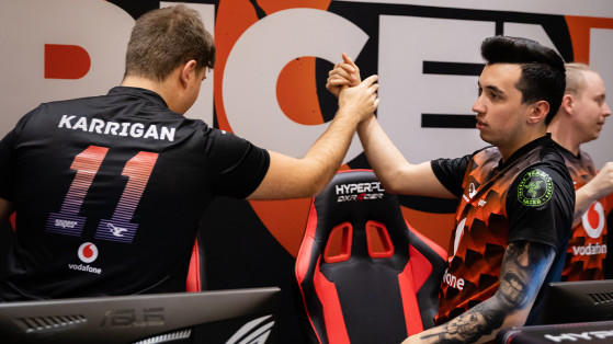 Karrigan [left] and Woxic [right] celebrate after a win. - CS:GO